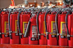 Commercial photography of row of fire extinguishers. These specialized industrial products were photographed on location in East Hanover, New Jersey